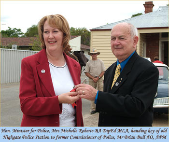 Hon. Minister for Police, Mrs Michelle Roberts BA DipEd MLA, handing key of old Highgate Police Station to former Commissioner of Police, Mr Brian Bull AO, APM